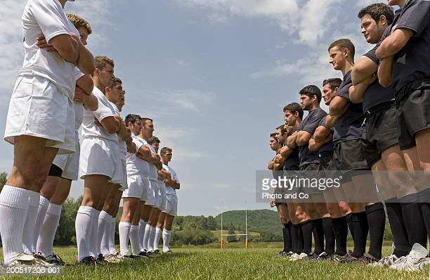 two rugby teams standing on pitch facing each other, low angle view - confrontation stock pictures, royalty-free photos & images