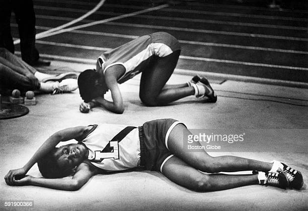 Two runners collapse from exhaustion after a race at a high school track meet at Harvard University in Cambridge Mass 1983 [Exact date unknown...