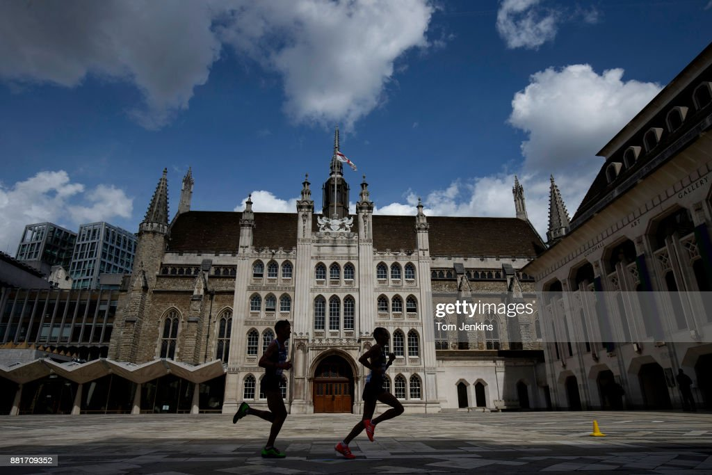 Two runners in the mens marathon cross the courtyard in front of the Guildhall during day three of the World Athletics Championships 2017 on August 6th 2017 in London