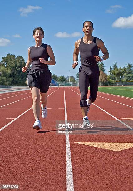 Two Runners Jogging on Race Track