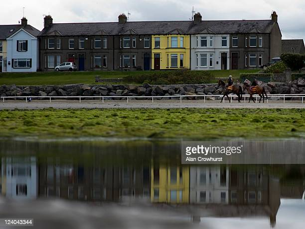 Two runners return to the stables after a canter during the Laytown race meeting run on the beach on September 08 2011 in Laytown Ireland