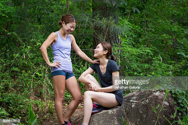 Two runners take a break and share a laugh