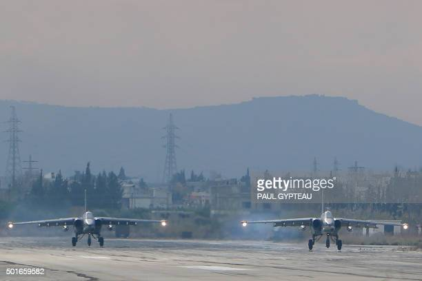 Two Russian Sukhoi Su25 bombers at the Russian Hmeimim military base in Latakia province in the northwest of Syria on December 16 2015 Russia began...