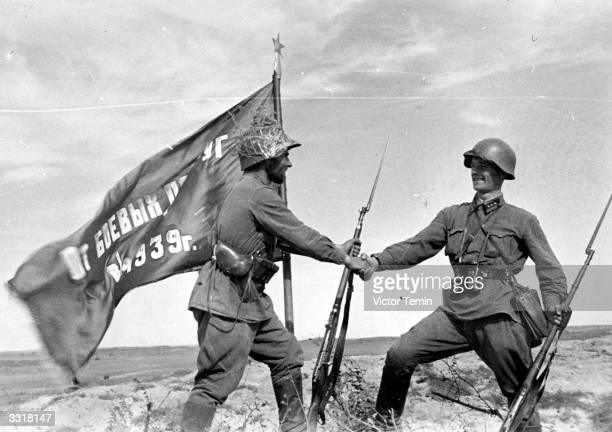 Two Russian soldiers congratulating themselves on the victory in Khalkhingol Mongolia where Soviet troops supported by Mongolian detachments routed...