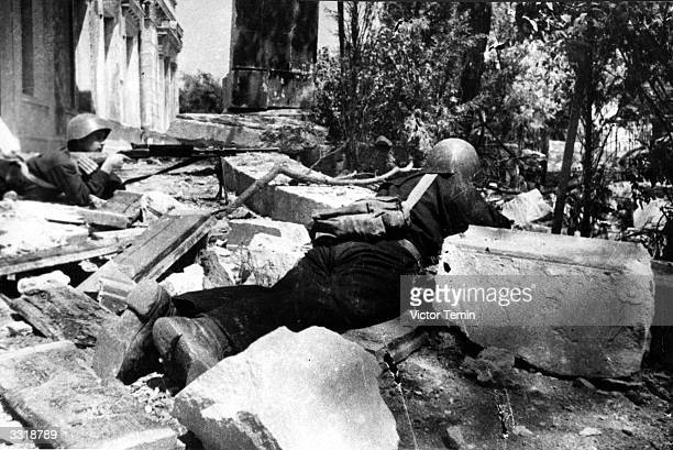 Two Russian soldiers positioned amongst the rubble in the defence of Stalingrad Russia