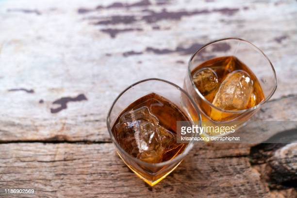 two rye whiskey cocktail drinks toasted together,addictive substance - bourbon whiskey stock pictures, royalty-free photos & images
