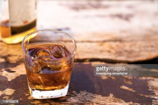 two rye whiskey cocktail drinks toasted together,addictive substance - bourbon whisky foto e immagini stock