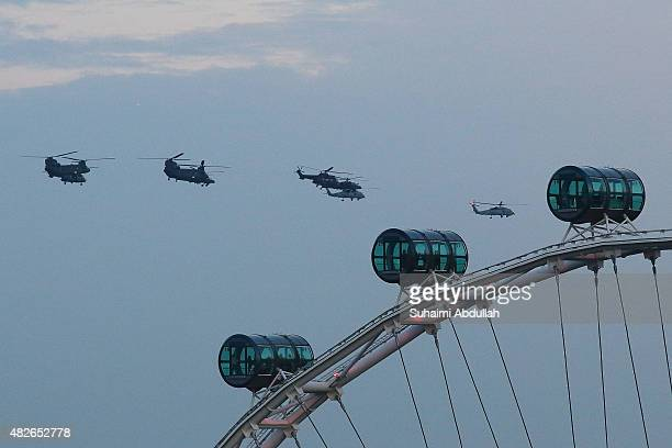 Two S70B naval helicopters and featuring two AS332 Super Pumas two AH64D Apaches and two Chinooks make a flypast with an ÒArrowheadÓ formation over...