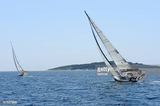 Two sailboats compeeting during regatta