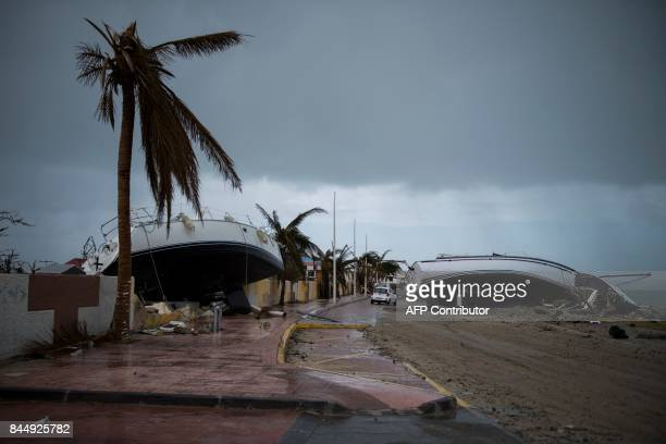Two sailing boats are beached on a road of Marigot on September 9 2017 in SaintMartin island devastated by Irma hurricane Officials on the island of...