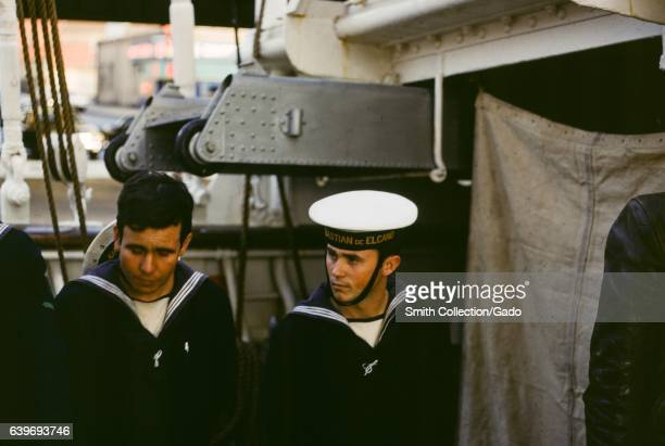 Two sailors in uniform aboard the Spanish navy training ship Juan Sebastian Elcano a tallship originally built in 1928 which is used to train sailors...