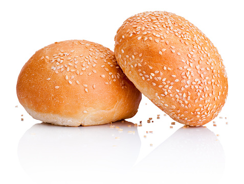 Two sandwich bun with sesame seeds isolated on white background 506784928