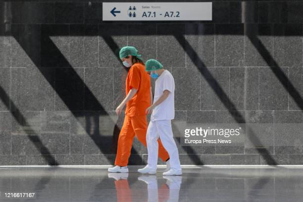 Two sanitary workers are seen at the campaign hospital of IFEMA established to help during the infection admitting coronavirus patients on April 03...