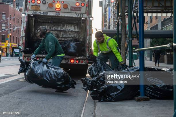 two sanitation workers cleaning the 23rd street in manhattan flatiron district from garbage during the coronavirus outbreak. - alex potemkin coronavirus stock pictures, royalty-free photos & images