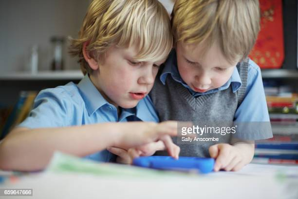 two school children doing their school work - schoolboy stock pictures, royalty-free photos & images
