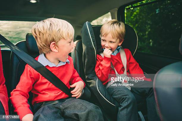 Two school children in the car