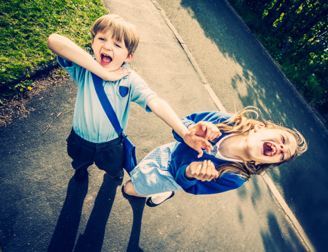 Two school children laughing - gettyimageskorea