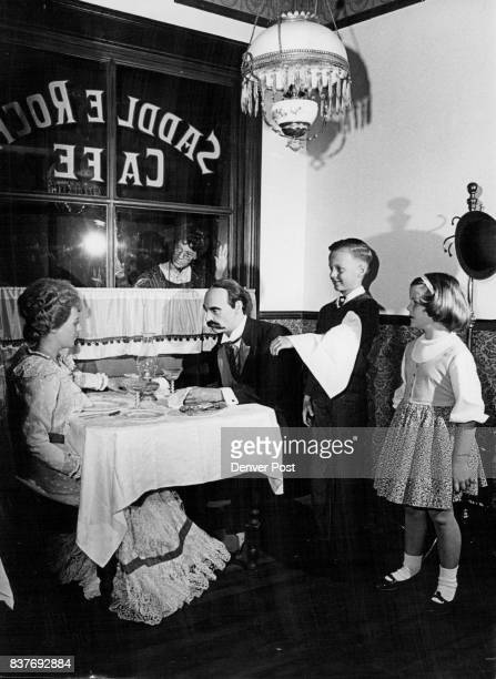 Two School Children Observe Historic Rendezvous Making like a waiter Dewey Clinton Fallis Elementary School fourth grader and Ann Johnson Carson...