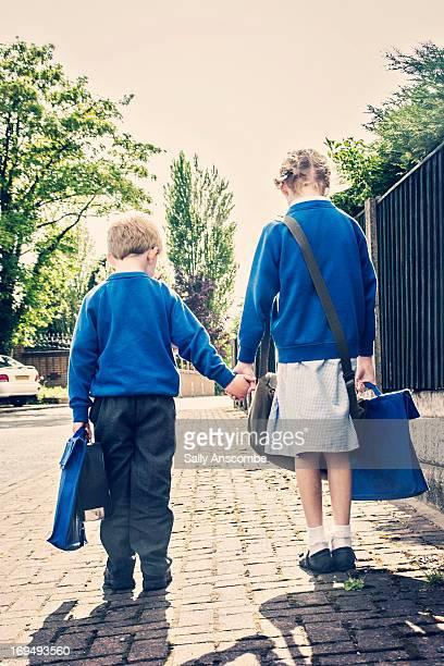 Two school children on their way to school