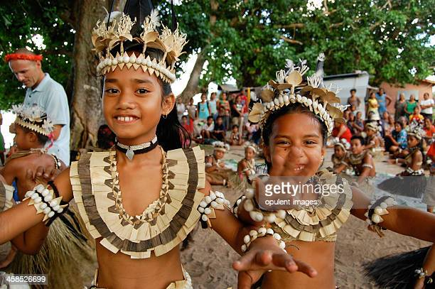 Two school children performing traditional dance