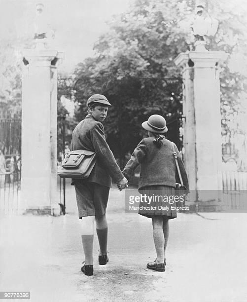 Two school children walking hand in hand 26 August 1960