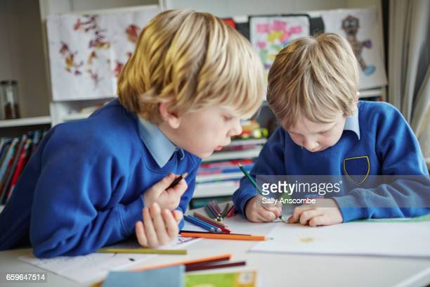 Two school children working together