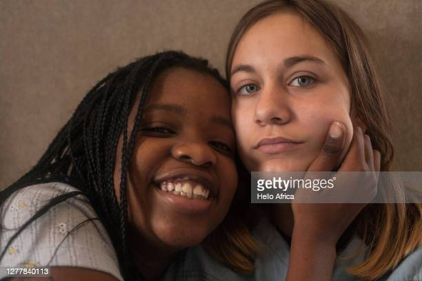 two school colleagues socialising after school - native african girls stock pictures, royalty-free photos & images