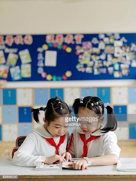 Two school girls studying together.