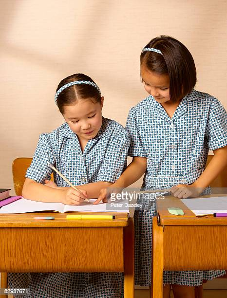Two school girls working together in