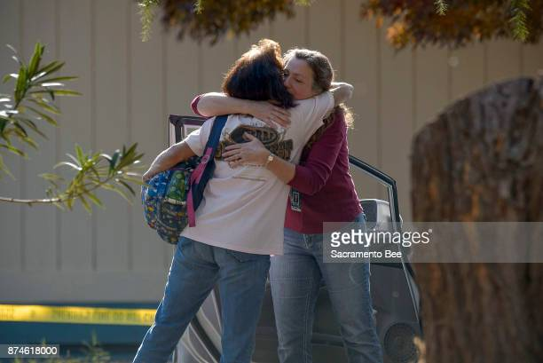 Two school officials embrace on the grounds of the Rancho Tehama Elementary school in Rancho Tehama Reserve in Corning Calif on Tuesday Nov 14 2017