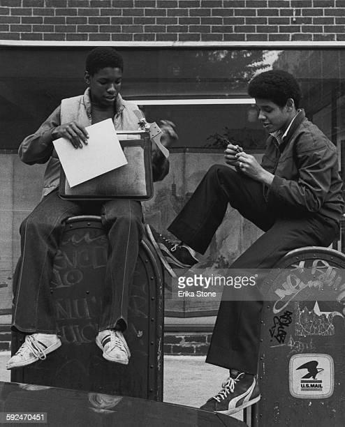 Two schoolboys after school in New York City circa 1980