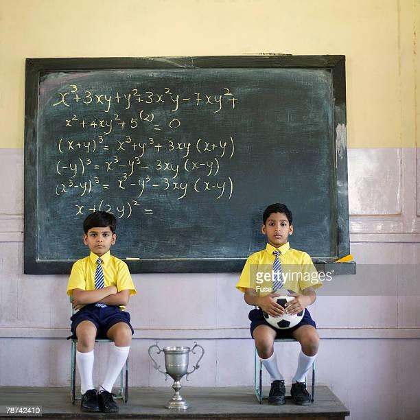 Two Schoolboys in Classroom