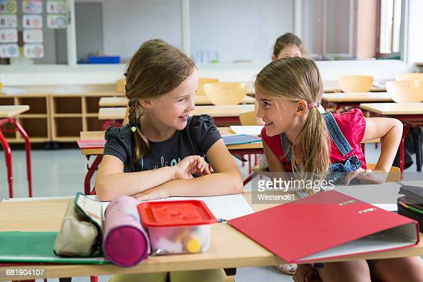 two schoolgirls at class - children only stock pictures, royalty-free photos & images