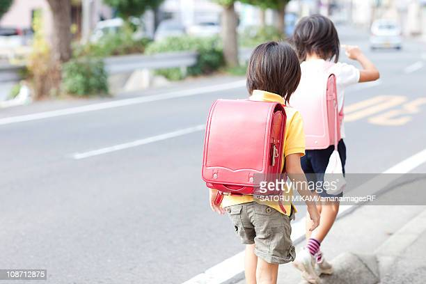 two schoolgirls commuting - children only stock pictures, royalty-free photos & images