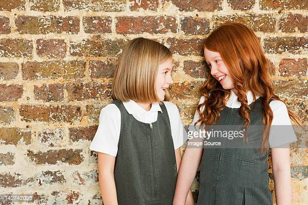 Two schoolgirls smiling