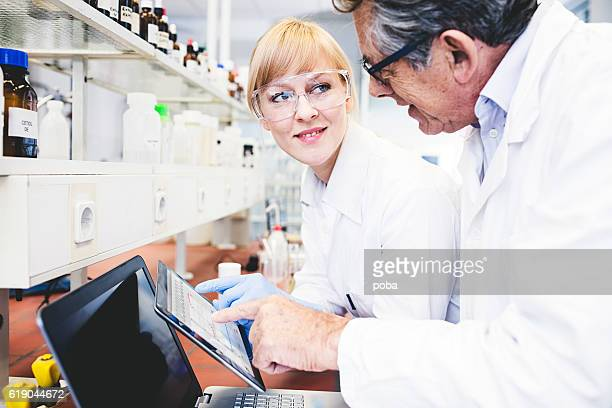 Two  Scientist Working On Computer
