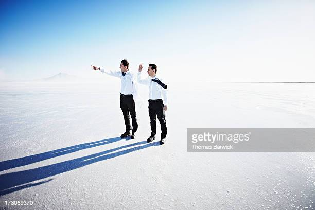 Two scientists on windy salt flats looking out