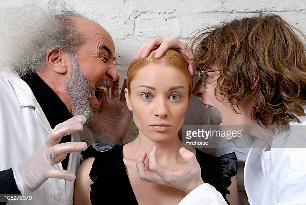Two Scientists Shouting at Young Woman