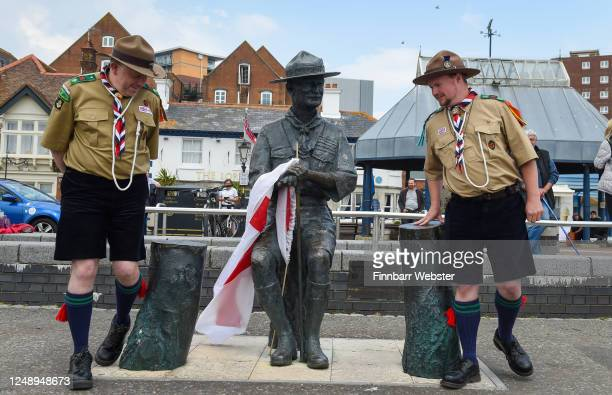 Two scouts arrive to show their support for the Lord Baden-Powell statue on June 11, 2020 in Poole, United Kingdom. The statue of Robert Baden-Powell...