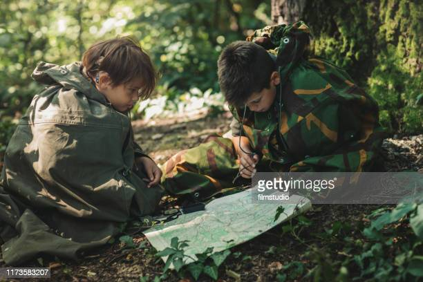 two scouts looking at the map - cochlear implant stock pictures, royalty-free photos & images