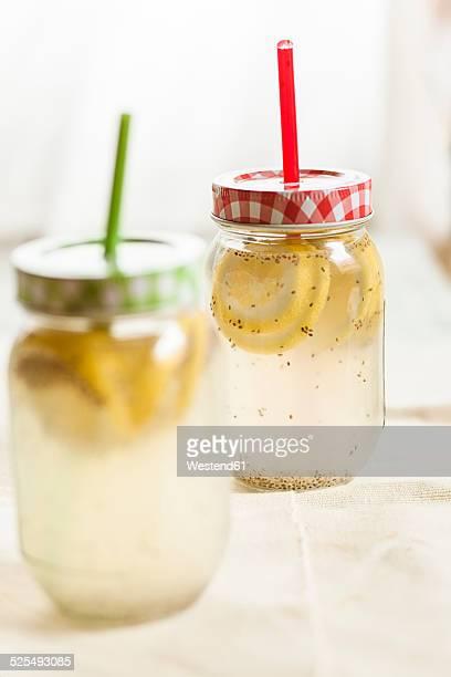 Two screw-top jar of chia fresca, mexican lemonade with chia seeds, Salvia hispanica