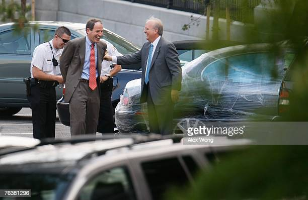 Two Secret Service officers pretend to handcuff Al Hubbard Director of National Economic Council after White House Deputy Chief of Staff Karl Rove...