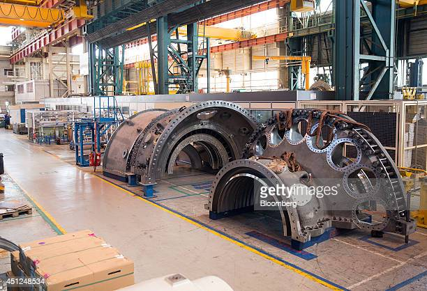 Two sections of a turbine unit sit under construction inside General Electric Co.'s power-generation plant in Belfort, France, on Tuesday, June 24,...