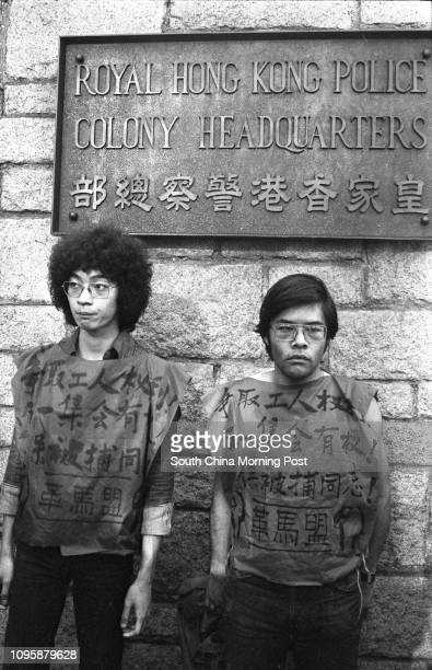 Two selfprofessed members of the Marxist Revolutionary League sitting outside the Royal Hong Kong Police Force Headquarters They are demanding...
