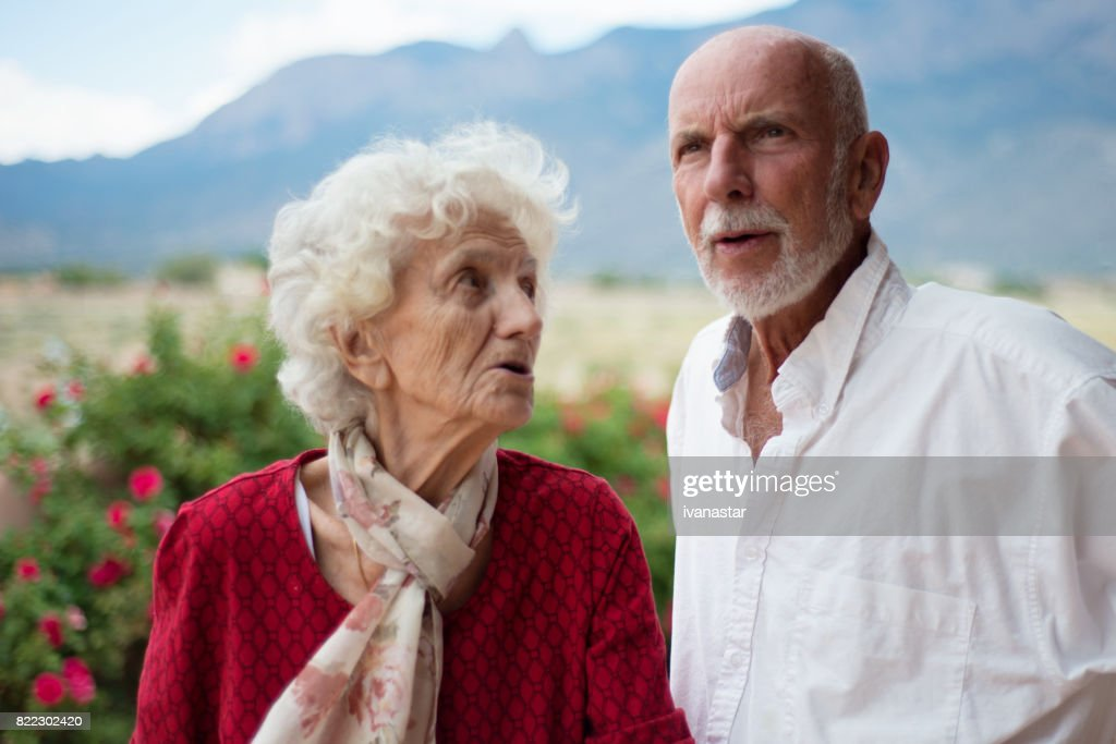Two Senior Adults Talking, Discussing and Laughing : Stock Photo