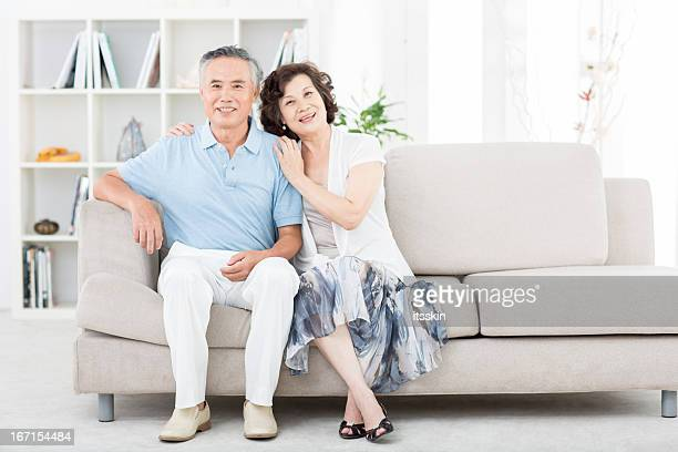 Two senior asian people at home
