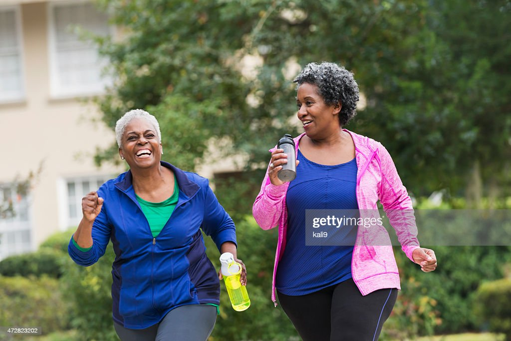 Two senior black women exercising together : Stock Photo