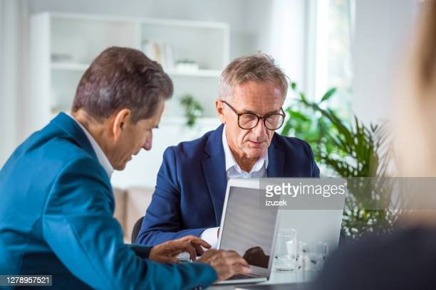 two senior businessmen in the office - izusek stock pictures, royalty-free photos & images