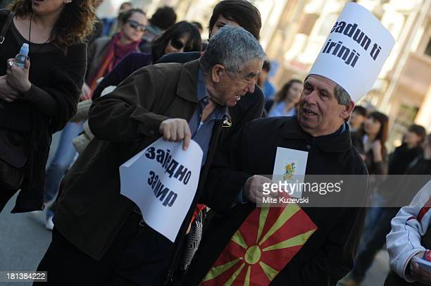CONTENT] Two senior citizens of Macedonia one ethnic Macedonian the other ethnic Albanian were marching for tolerance and nonviolence after several...