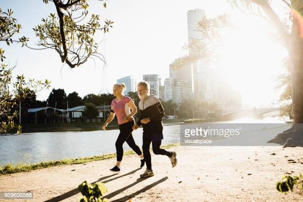 Two senior friends running together in Melbourne